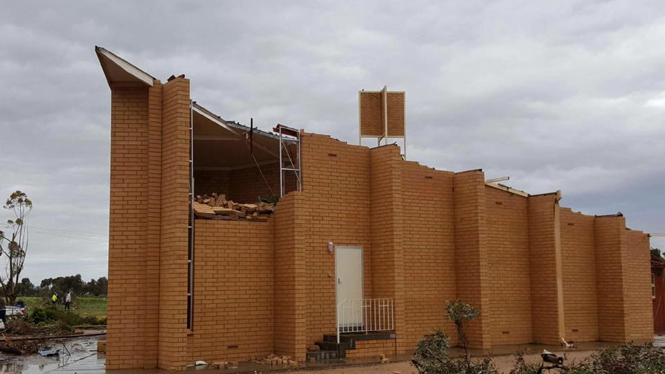 Sturdy building with parts of its wall caved in and roof gone in Blyth. Image Credit: Michelle Morris