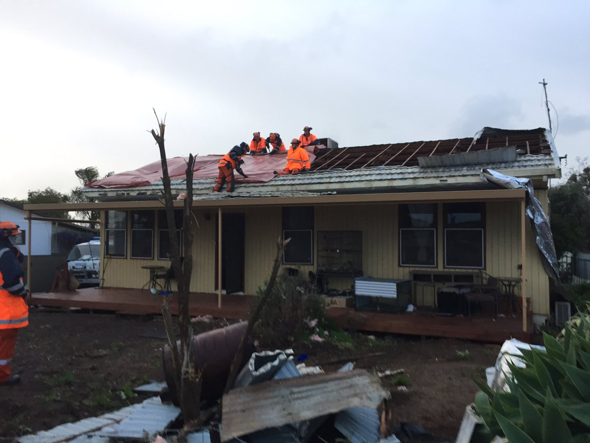 SES workers fixing a roof from a property in Blyth after a Tornado struck. Image Credit: Tornado damage on a farm in Melrose. Image Credit: Tom Fedorowytsch