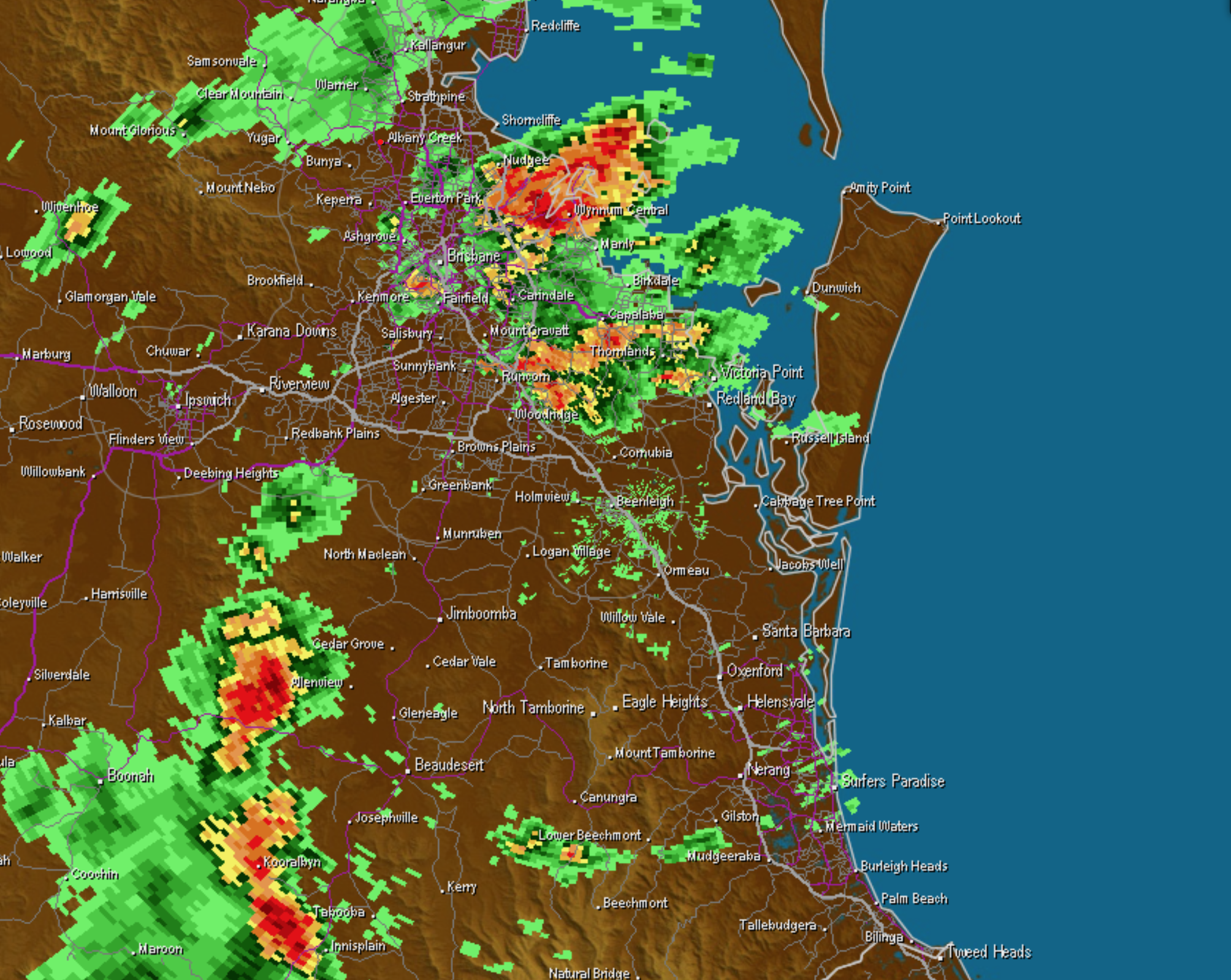 2pm radar view via Weatherzone showing the cell over Brisbane Airport