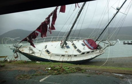 Boats washed ashore at Shute Harbour via Dockwalk on Twitter