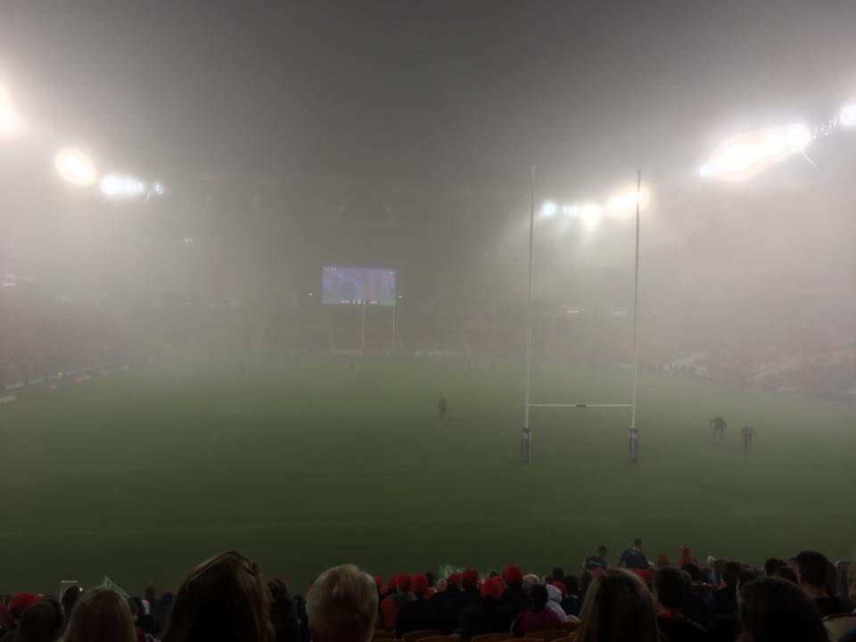 The Reds game was near impossible to watch as the cloud engulfed Suncorp. Image via James Caughlin
