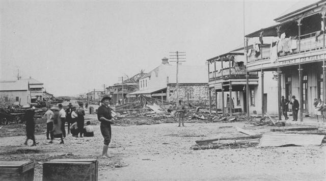 River Street, Mackay following the Cyclone. Image via the State Library