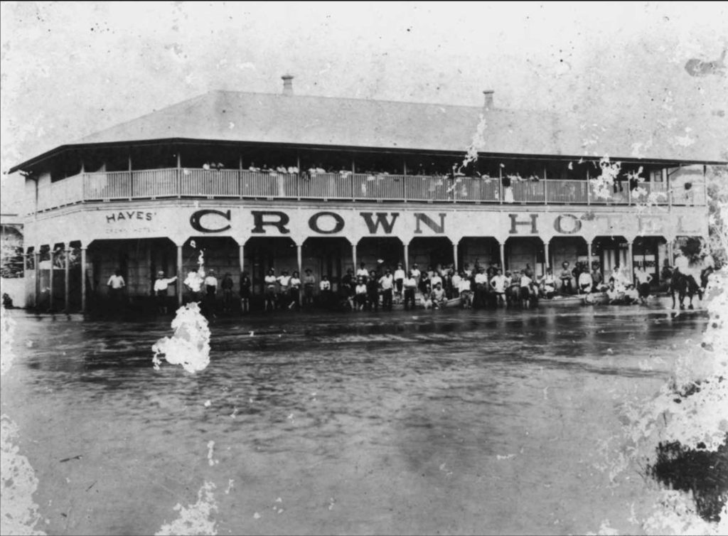 The Crown Hotel at Home Hill following the destroying tidal surge and record rainfall. Image via the State Library of Queensland